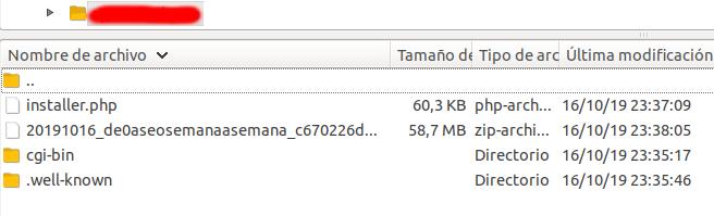 Vista de los ficheros del duplicator del wordpress a migrar en el gestor de FTP filezilla